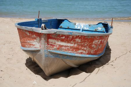 tatty: An old wooden fishing boat on a beach
