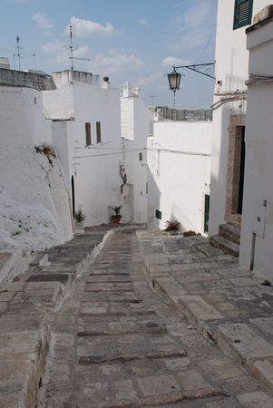 southern europe: A street in the southern Italian city of Ostuni, known as The White City  Stock Photo