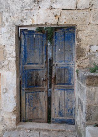 An old door in the Caveoso Sassi in the Italian town of Matera in the region of Basilicata.