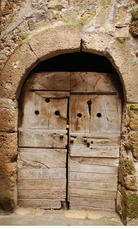 An old wooden door in Tuscany, Italy with the word lavatoi meaning washrooms on it  photo