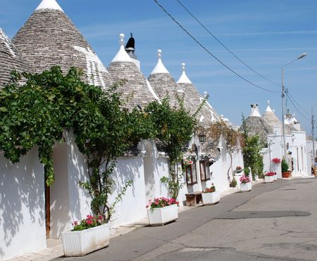 A street of traditional trulli house in Alberobello in Puglia, southern Italy