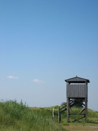 raised viewpoint: A small wooden disused bird observation point located within the Po Estuary in Italy.   Stock Photo