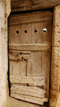 An old wooden door on a building in the historic town of Pitigliano, Tuscany, Italy   Stock Photo - 3830986