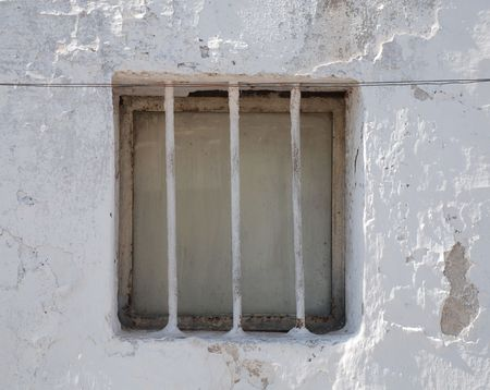 southern europe: A barred window in a whitewashed wall on old building in Puglia, southern Italy  Stock Photo