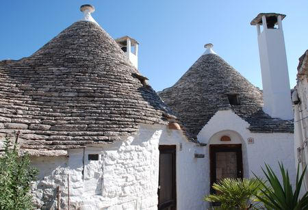 conical: A traditional trullo house in Alberobello in Puglia, southern Italy. The trulli, which are protected under UNESCO World Heritage laws, are traditional limestone houses with domed or conical roofs, and are common in the Alberobello region