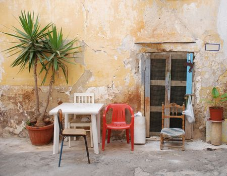 tatty: The front of an old house in the southern Italian port town of Gallipoli  Stock Photo
