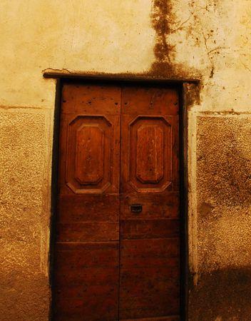 tatty: A old wooden door in Badalucco, Italy.  Stock Photo