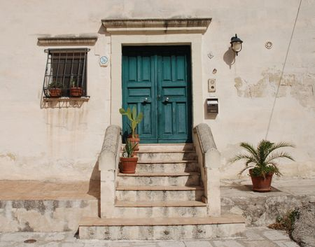 A door in the Caveoso Sassi in the Italian town of Matera in the region of Basilicata. The town is famous these stone houses which are a UNESCO World Heritage Site  Stock Photo - 4260462
