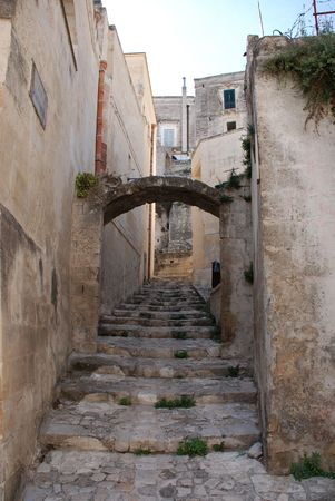 A street in the Barisano Sassi in the Italian town of Matera in the region of Basilicata. The town is famous these stone houses which are a UNESCO World Heritage Site  photo