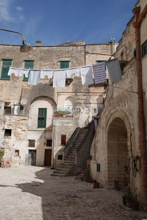 A street in the Caveoso Sassi in the Italian town of Matera in the region of Basilicata. The town is famous these stone houses which are a UNESCO World Heritage Site Stock Photo - 4260306