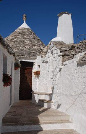 A traditional trullo house in Alberobello in Puglia, southern Italy. The trulli, which are protected under UNESCO World Heritage laws, are traditional limestone houses with domed or conical roofs, and are common in the Alberobello region  photo