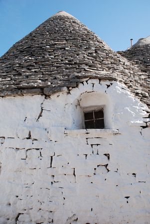southern europe: The wall of a traditional trullo house in Alberobello with a small window in it. The Trulli of Alberobello are protected as a UNESCO World Heritage site.
