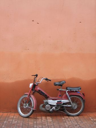 A moped leaning against a wall, Marrakesh, Morocco