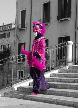 bw: A carnival goer poses for photographs at the Venice Carnival Stock Photo