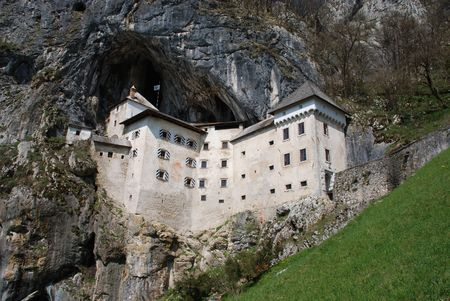 The historic Predjama Grad castle in Slovenia which dates back to the twelfth century. The fairytale-like castle is located in a limestone cliff in a cave entrance.