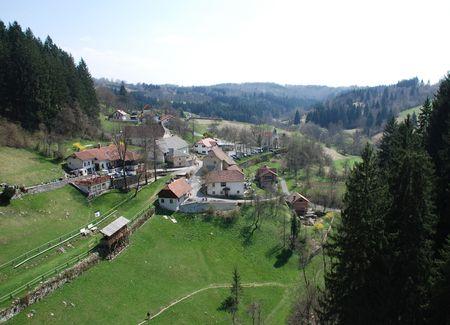 cuntry: The small Slovenian village of Predjama,  taken from the adjacent Predjama Grad castle