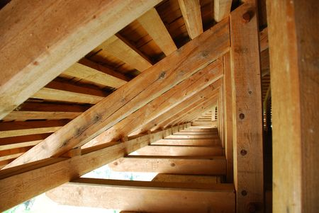 The beams inside a new wooden roof