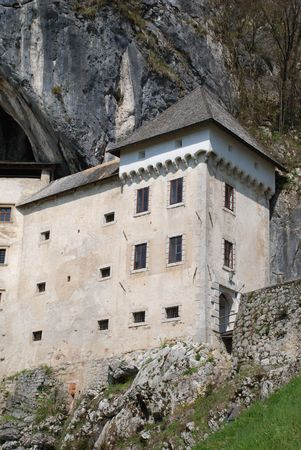 The historic Predjama Grad castle in Slovenia which dates back to the twelfth century. The fairytale-like castle is located in a limestone cliff in a cave entrance. photo