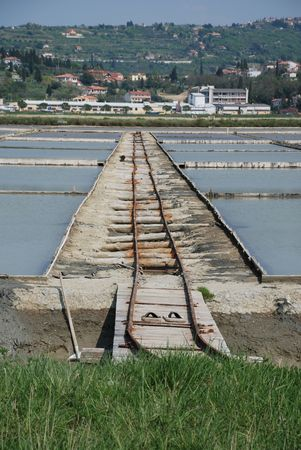 crystallization: Tailer tracks in the salt crystallization fields in the salt flats near Seča in Slovenia
