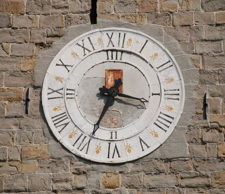 slovenian: The clock on the 13th century romanesque tower in the historic Slovenian coastal town of Koper