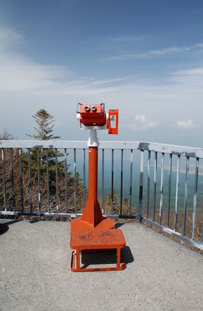 operated: A red coin operated viewing binocular located at the 5th station at Mount Fuji in Japan