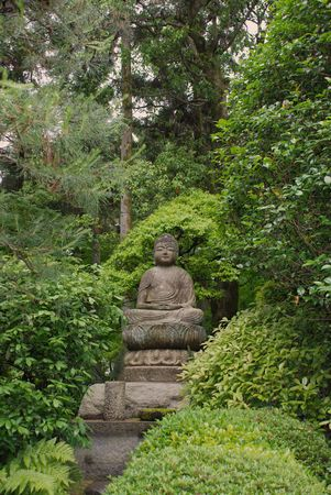 woodland sculpture: A Buddha statue in the shady gardens at Ryoanji Temple in Kyoto  Stock Photo