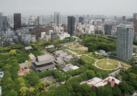A panarama of Tokyo taken from the observation floor of Tokyo Tower. Zojo-Ji Temple and its cemetery can be seen in the foreground