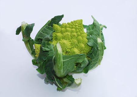 logarithmic: A green organic Brassica Oleracea, a variant form of cauliflower commonly called Romaneco Cauliflower which is also known as Romanesco Broccoli. The vegetable shows a distinctive fractal pattern and a logarithmic spiral.   Stock Photo