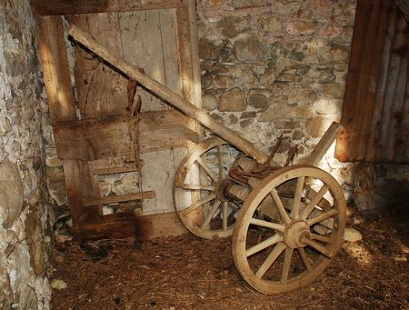 nineteenth: A nineteenth century wooden animal-pulled cart in a derelict Italian farm building