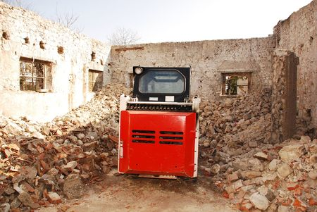 skid steer: A skid steer loader in a partially demolished derelict old Italian farm building