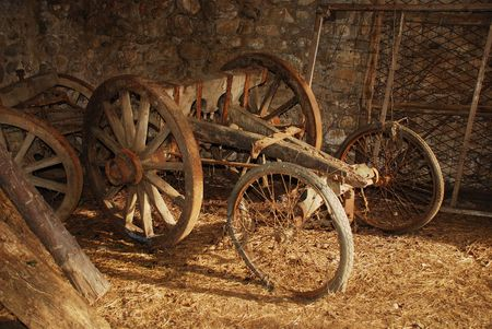 A nineteenth century wooden animal-pulled cart in a derelict Italian farm building