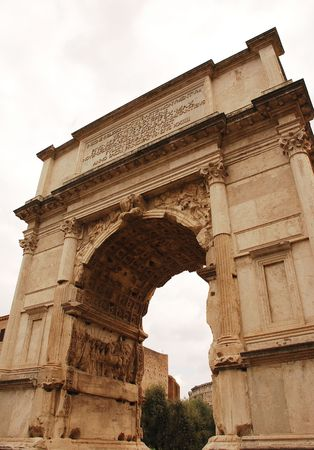 The first century Arch of Titus located in the Roman Forum on Via Sacra, Rome, Italy. It was built in 82 AD by the Emperor Domition to commemorate his bother Tituss victories  Stock Photo