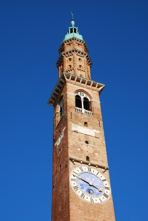 reconstructed: The Torre Bissara clocktower on the Basilica Palladiana in Piazza dei Signori, Vicenza, Italy. Originally constructed in the 15th century, this UNESCO World Heritage Site Renaissance building was later partly reconstructed by Palladio