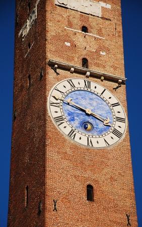 clocktower: The Torre Bissara clocktower on the Basilica Palladiana in Piazza dei Signori, Vicenza, Italy.  Stock Photo