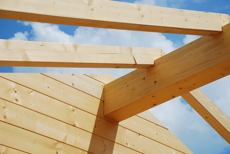 Main roof beam detail on a partially constructed wood (fir) block house, a pre-cut wooden house which is assembled on-site Stock Photo
