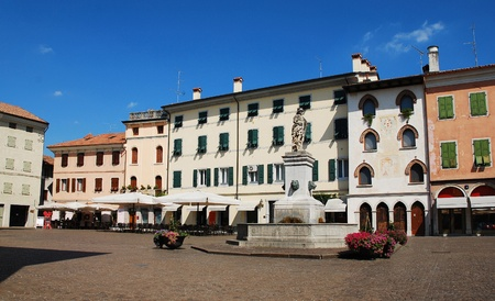Piazza Paolo Diacono in the UNESCO World Heritage Centre town of Cividale Del Friuli, Italy.  The statue atop the fountain features four lion heads and Diana The Hunter, and was donated to the city by Earl de Claricini of Bottenicco Stock Photo