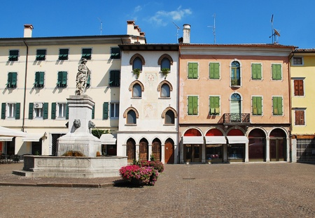 Piazza Paolo Diacono in the town of Cividale Del Friuli, Italy.  The statue atop the fountain features four lion heads and Diana The Hunter, and was donated to the city by Earl de Claricini of Bottenicco Stock Photo