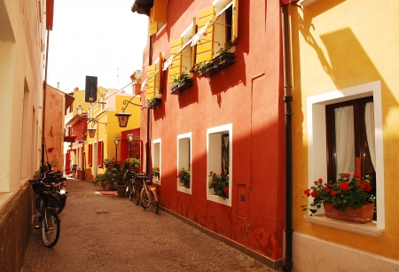 An historic backstreet in the seaside town of Caorle in the Veneto region of Italy.