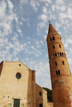 saint stephen cathedral: The byzantine Santo Stefano (Saint Stephen) Cathedral and the 11th century belltower in Caorle in the Veneto region of Italy.