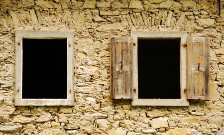 watermills: Windows in an old abandoned mill near Salino in Friuli, north east Italy  Stock Photo