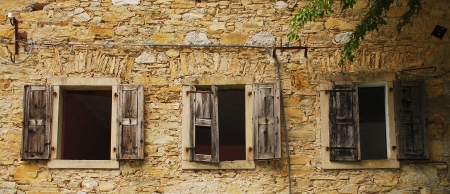 watermills: Windows in an old abandoned mill near Salino in Friuli, north east Italy  Editorial
