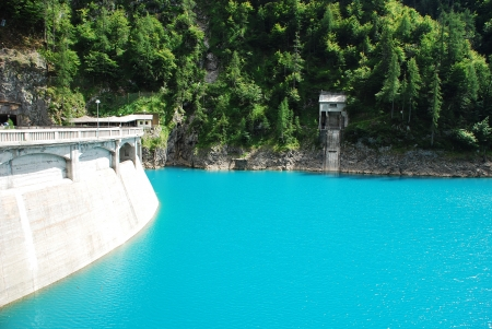 artificially: The blue waters of the artificially created lake Lago di Sauris  Zahre  in north east Italy  The dam can be seen on the left  Stock Photo