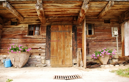 The front door of an old wooden agricultural building in a north eastern Italian village photo