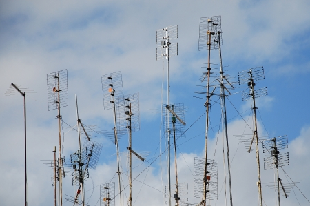 patchy: Lots of aerials sticking up into a patchy cloudy sky