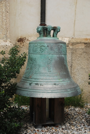 The bell outside the parish church of Sentjakob  Saint Jacob  in Skofja Loka, Slovenia Stock Photo - 23469387