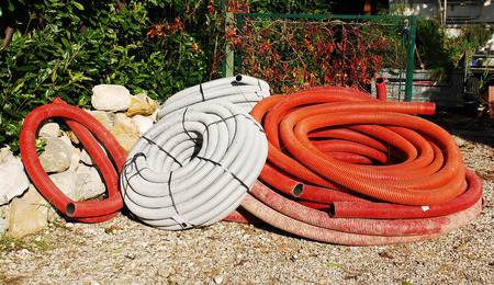 conduit: Rolls of conduit piping at the entrance to a small domestic building site