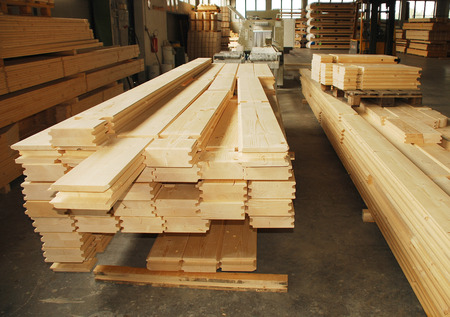 Individual cuts of wood for a prefabricated wooden  fir  house in their factory of manufacture