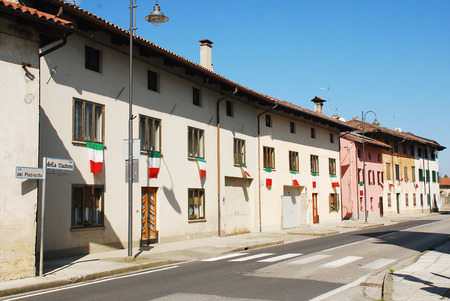 Risano, Italy - 9th March 2014  The village is decorated in Italian flags - the Il Tricolore - in celebration for an Alpini event in the village