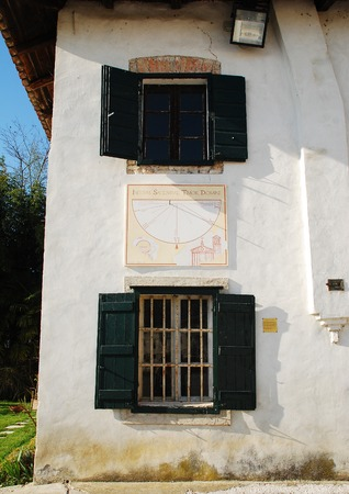 A wall on the exterior of the Friulian Farming Culture Museum  Museo della Civilta Contadina del Friuli Imperiale  in Aiello del Friuli, Italy  This one shows a sundial from 2000 known as Meridiana ad Ore Canoniche or Canonical Hours Solar Clock