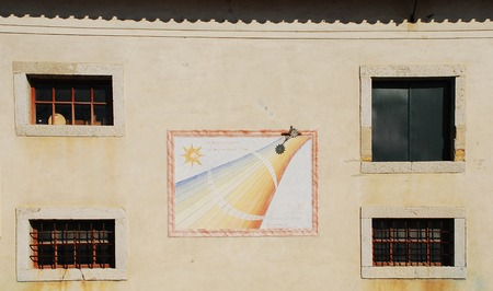 A wall on the exterior of the Friulian Farming Culture Museum  Museo della Civilta Contadina del Friuli Imperiale  in Aiello del Friuli, Italy  This one shows a sundial known as the Calendario Solare or Solar Calendar which has a sun-shaped copper disc th